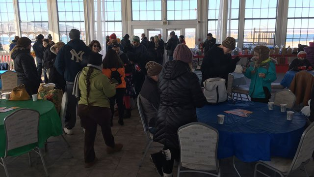 People waited anxiously  to take the polar plunge in New Haven on Monday. (WFSB)