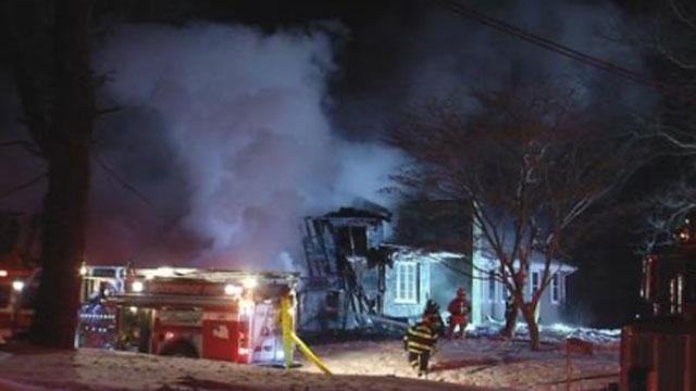 Crews battle house fire in Woodbridge on Friday evening. (WFSB)