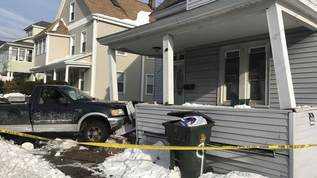 A truck crashes into the porch of a New London home on Monday morning. (New London Fire Department)