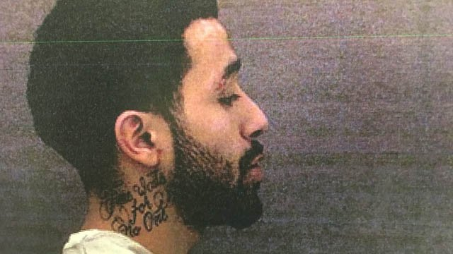 "Escaped inmate Jerry Mercardo has a tattoo that reads ""time waits for no one"" on his neck. (DOC)"