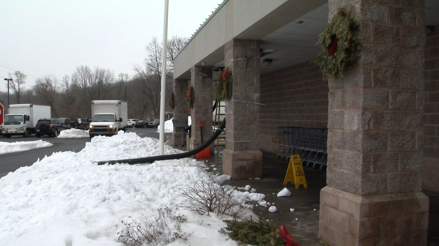 West Side Market in Rocky Hill cleared snow from its roof in anticipation of Friday's rain and potential flooding. (WFSB)