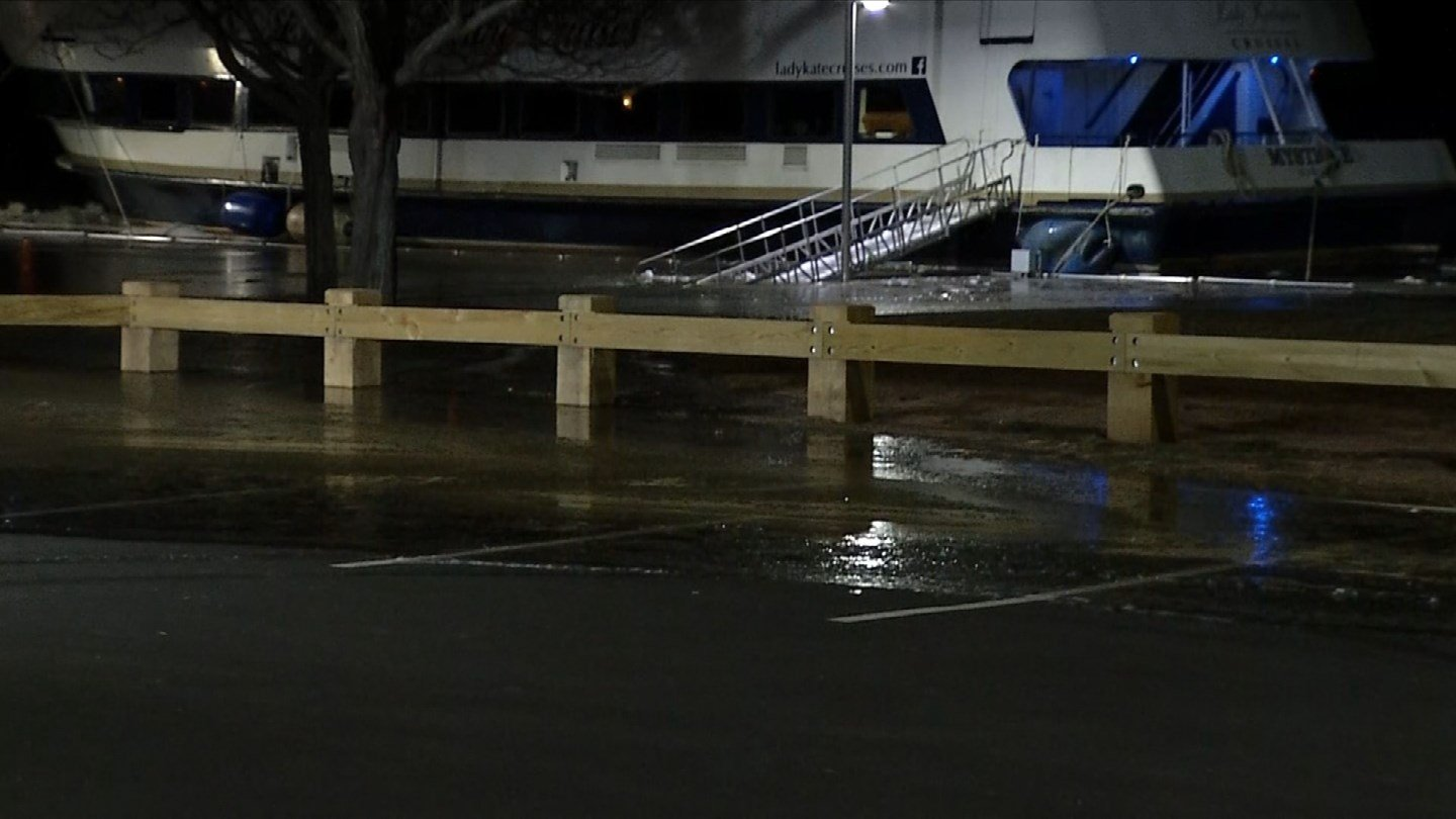 A partially submerged and frozen ramp leading to a river cruise ship in Middletown's Harbor Park on Tuesday. (WFSB)