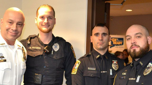 Bristol police chief Brian Gould and the rest of his department honored Officers Seth Petzing, Vincenzo Infante and Conor Hogan.