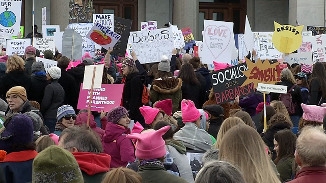 Thousands of woman mirror thousands marching for women's issues (WFSB)