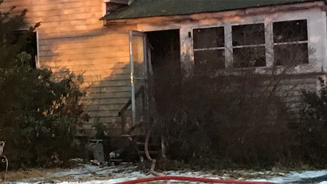 Firefighters in Plainville are on the scene of a house fire on Monday morning. (WFSB)