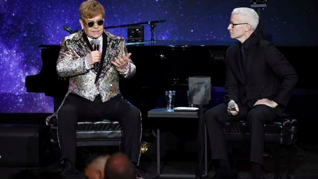 Singer Elton John announces final world tour in an interview with CNN news anchor Anderson Cooper at Gotham Hall on Wednesday, Jan. 24, 2018, in New York. (Photo by Evan Agostini/Invision/AP)