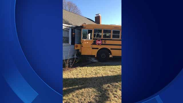 A school bus hit a house in Meriden on Friday afternoon (@jcarabetta)