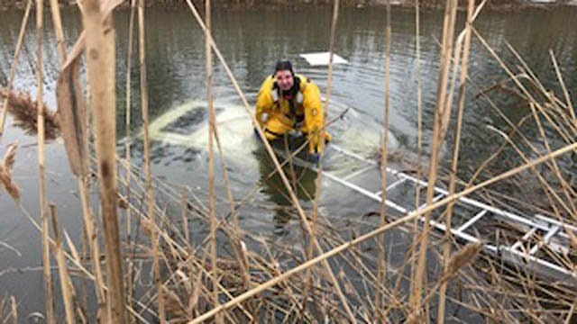 A car went into a canal on Spring Street in West Haven on Tuesday morning. (West Haven police)