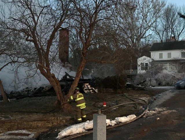 Only the chimney stands after a fire tore through a home on Knowles Road in East Hampton. (WFSB)