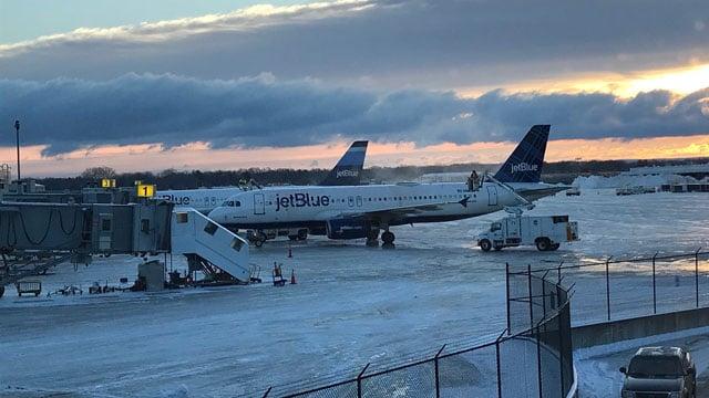 Crews worked to clear runways at Bradley International Airport in Windsor Locks. (WFSB)