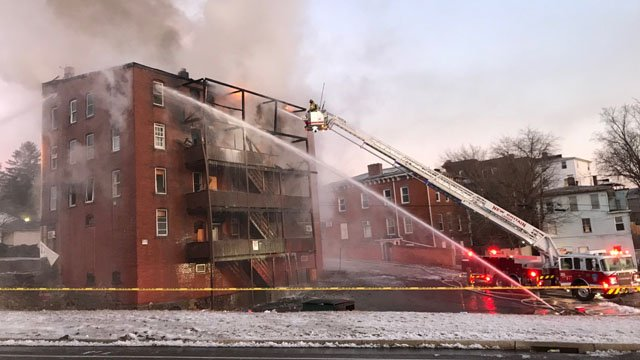 Fire crews had to use ladder trucks to battle a fire on Arch Street in New Britain. (WFSB)