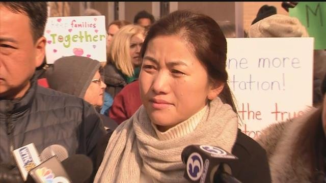 A crowd rallied around a couple facing deportation on Friday. (WFSB)