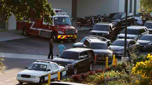 Police and rescue vehicles are shown outside Broward Health North hospital. A shooter opened fire at a Florida high school killing 17. (AP Photo/Joe Skipper)