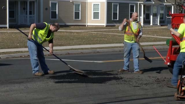 During the warmer weather, crews are working to repair potholes (WFSB)