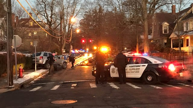 A stolen vehicle crash closed Fern and North Beacon streets on the West Hartford/Hartford line Friday morning. (WFSB)