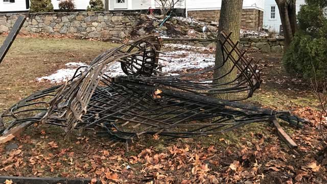A broken fence was the result of a stolen vehicle crash on the West Hartford/Hartford line on Friday. (WFSB)