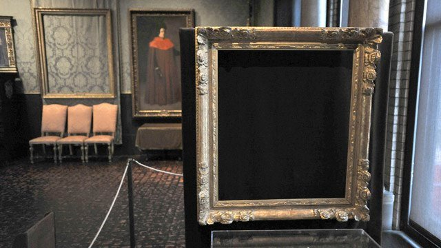"Empty frames from which thieves took ""Storm on the Sea of Galilee,"" left background, by Rembrandt and ""The Concert,"" right foreground, by Vermeer, remain on display at the Isabella Stewart Gardner Museum in Boston. (AP)"