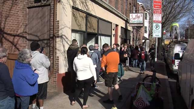 People lined up for Sally's pizza on Wednesday in New Haven (WFSB)