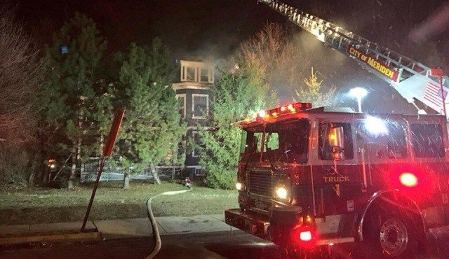 Firefighters are battling a house fire in Meriden on Sunday evening.  (WFSB)