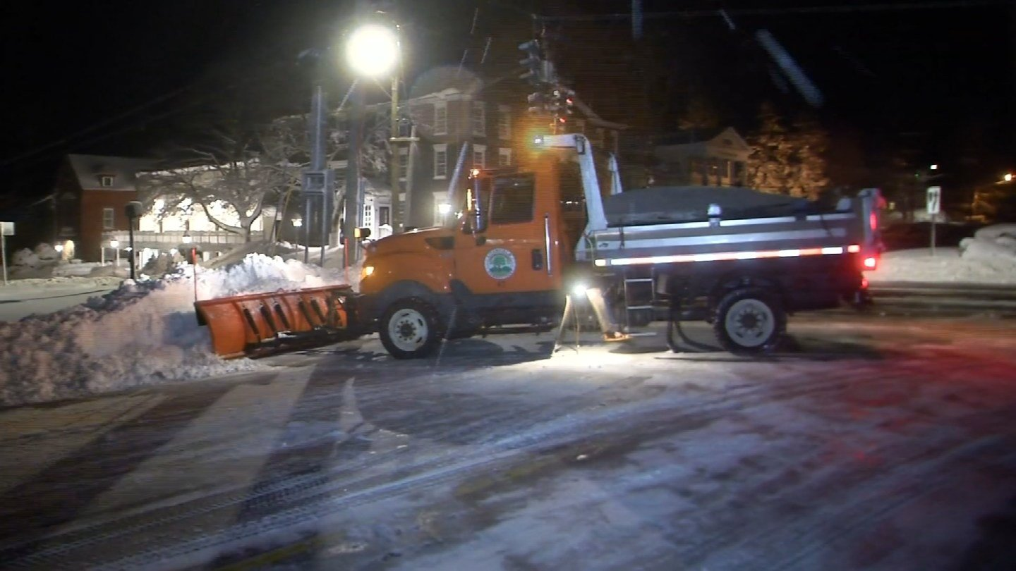 Plow truck drivers piled snow around the Litchfield Green on Thursday morning. (WFSB)