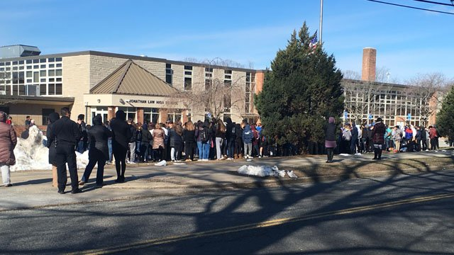 Students walked out of Jonathan Law High School in Milford on Wednesday morning. (WFSB)