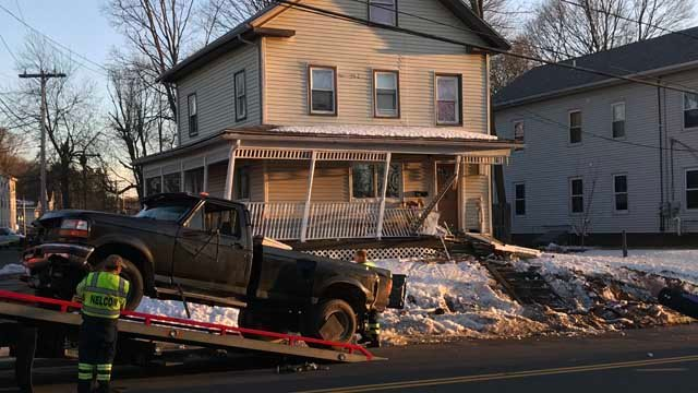 A truck hit a home in Meriden on Monday afternoon (WFSB)
