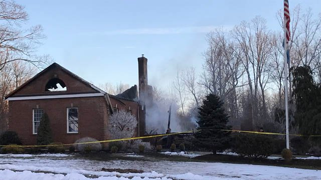 The shell of a home on Cliffwood Drive in South Windsor is all that remains after a Tuesday morning fire. (WFSB)