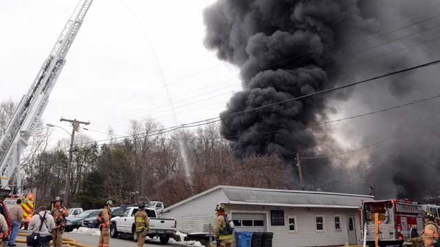 Crews battled a huge fire at Boyd's Auto in Norwich on Thursday (John Shishmania/Norwich Bulletin)