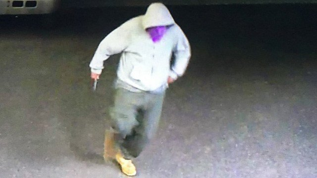Police seek suspect in armed robbery of business