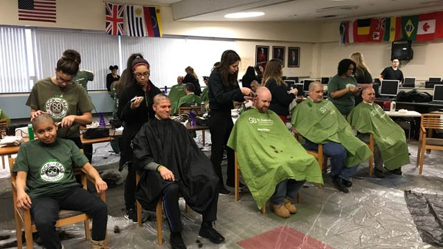 Students, faculty and others shaved their heads for the St. Baldrick's Foundation at Platt High School in Milford on Wednesday. (WFSB)