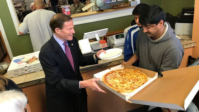 Sen. Richard Blumenthal showed his support of a couple facing deportation by buying a pizza from their business in New Britain on Friday. (WFSB)