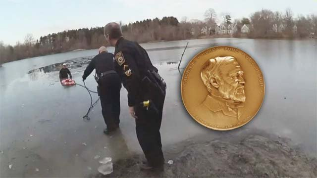 Police body camera shows Milford officers helping John O'Rourke back to shore. (Milford Police)