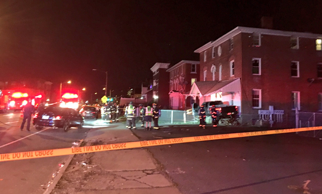 Crews on scene of a car into a building in Hartford (WFSB)