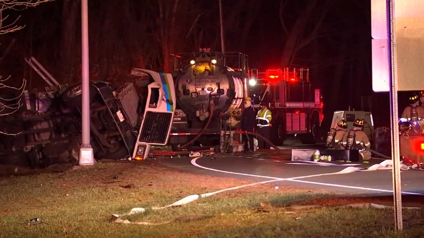 Cleanup of a overturned tanker and gas spill continued on an I-91 off-ramp in Enfield on Tuesday morning. (WFSB)
