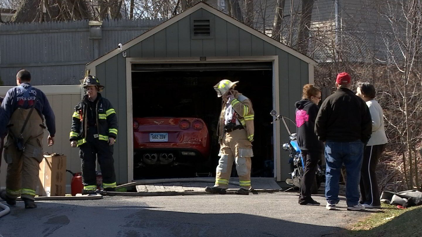 A Corvette caught fire in a garage on Atkins Street in Meriden on Wednesday. (WFSB)