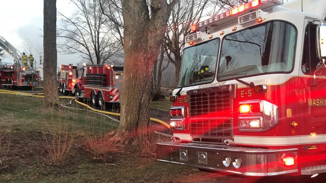 A barn smolders on Scofield Hill Road in Washington Thursday morning. (WFSB)