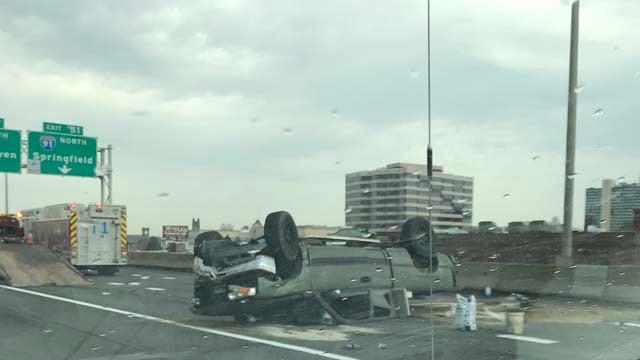 A rollover crash on I-84 in Hartford caused a fuel leak (WFSB)