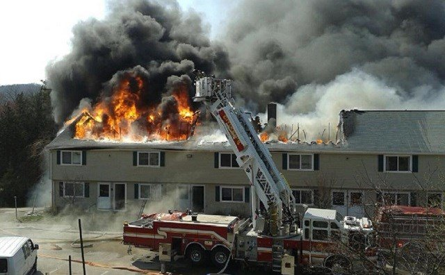 Firefighters battle large apartment complex fire in Seymour