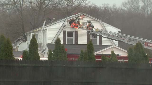 Crews worked to put out a fire in Wallingford Monday morning (WFSB)