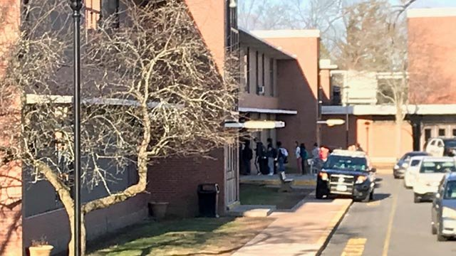 Students had their bags check on their way into Manchester High School following a threat. (WFSB)