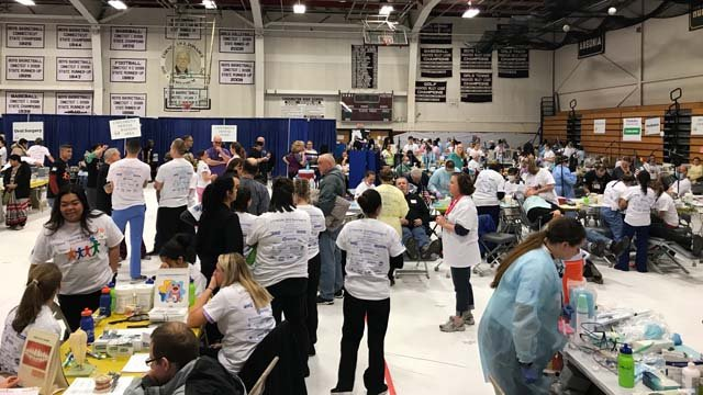 The Mission of Mercy at Torrington High School reached capacity on Friday morning just as it opened. (WFSB)