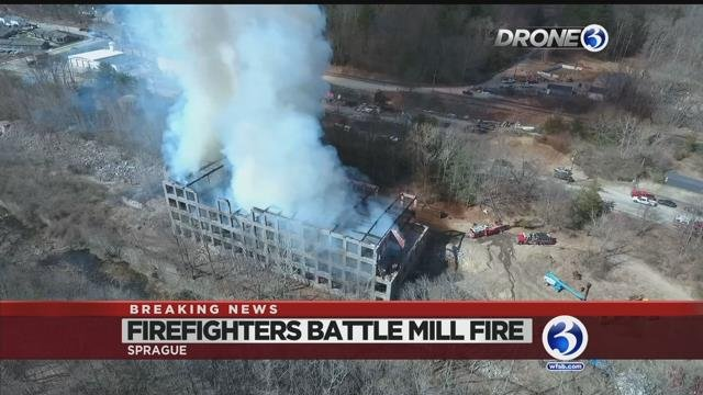 Video: Dozens of firefighters battle Baltic mill fire