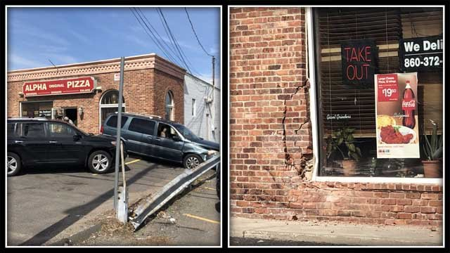 A car hit a building on the Silas Deane Highway on Tuesday (WFSB)