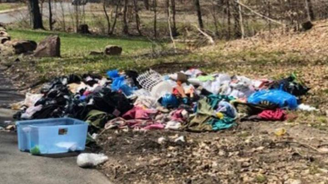 Hartford's DPW said police arrested a suspect for dumping dozens of bags of household trash on Love Lane. (Hartford DPW)