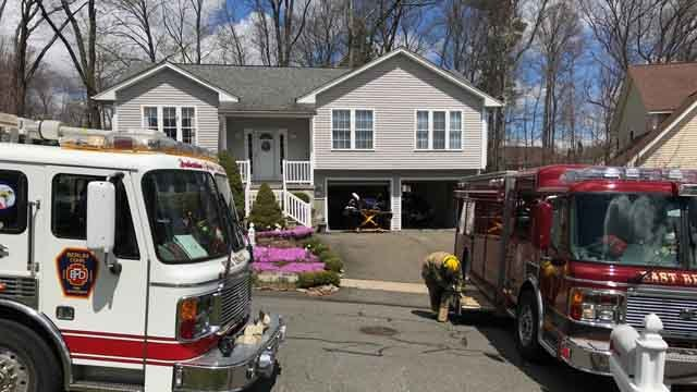 A car crashed through the back of a garage of a home in Berlin on Thursday (WFSB)