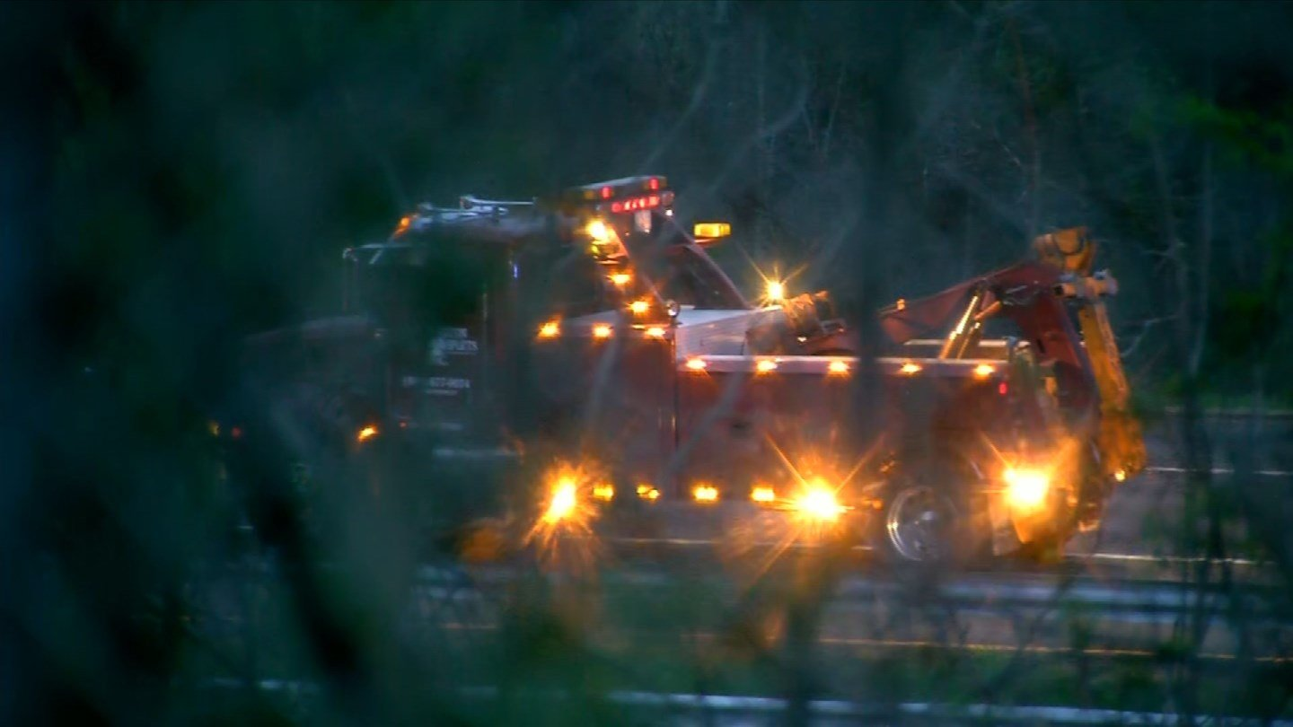 A tow truck was on the scene of a one-car fatal crash on I-84 east in Farmington. (WFSB)