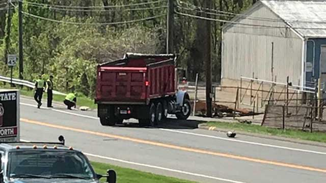 A motorcycle and dump truck collided in Enfield on Tuesday afternoon (WFSB)