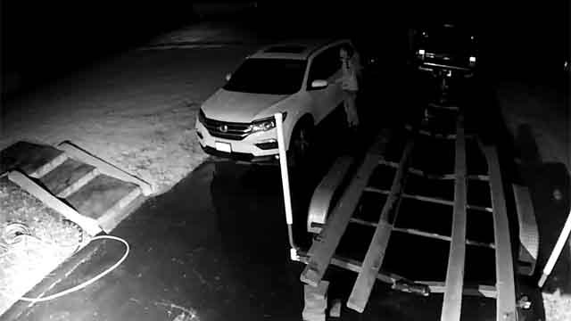 North Haven police released surveillance video of a suspect trying to break into a car (North Haven Police)