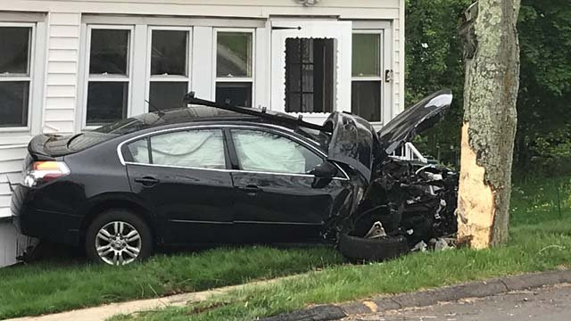 A car slammed into a home on Pine Rock Avenue in Hamden Tuesday morning. (WFSB)