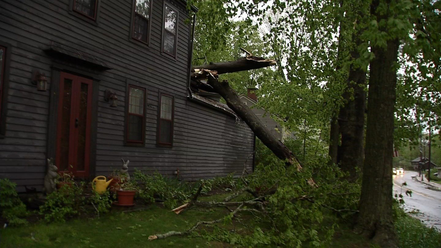 Homes were damaged by trees in both Brookfield and Danbury during Tuesday night's storms. (WFSB)